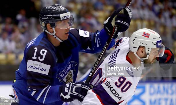 Veli Matti Savinainen of Finland and Daniel Sorvik of Norway battle for position during the 2018 IIHF Ice Hockey World Championship group stage game...