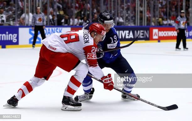 Veli Matti Savinainen of Finland and Emil Kristensen of Denmark battle for position during the 2018 IIHF Ice Hockey World Championship group stage...