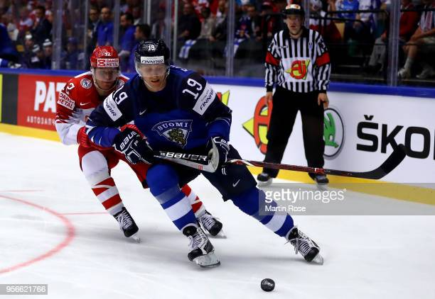 Veli Matti Savinainen of Finland and Mads Christensen of Denmark battle for the puck during the 2018 IIHF Ice Hockey World Championship group stage...