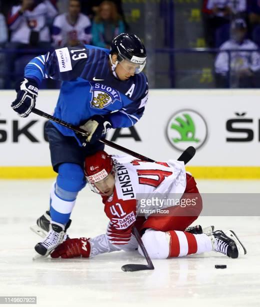 Veli Matti Savinainen of Finland challenges Jesper Jensen Aabo of Denmark during the 2019 IIHF Ice Hockey World Championship Slovakia group A game...