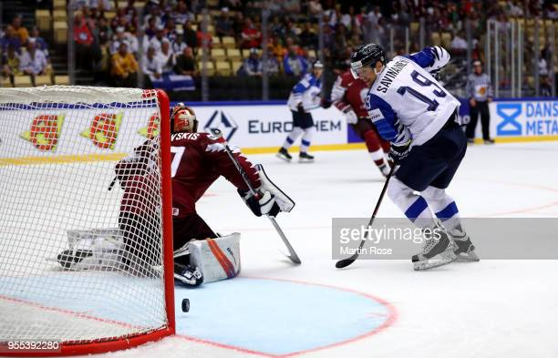 Veli Matti Savinainen of Finland scores his teams 2nd goal during the 2018 IIHF Ice Hockey World Championship group stage game between Latvia and...