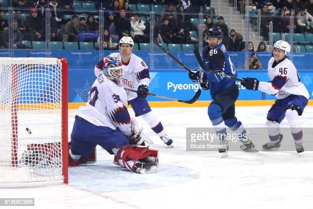 Veli-Matti Savinainen of Finland celebrates after scores a goal against Lars Haugen of Norway in the third period during the Men's Ice Hockey...