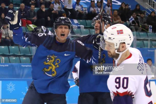 Veli-Matti Savinainen of Finland celebrates after scoring against Lars Haugen of Norway in the third period during the Men's Ice Hockey Preliminary...