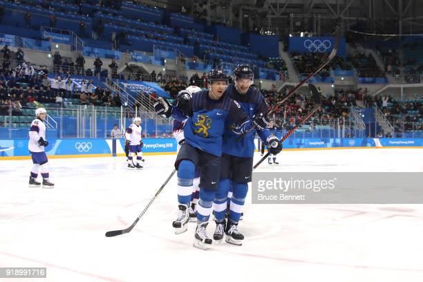 Veli-Matti Savinainen of Finland celebrates with teammate Jarno Koskiranta after scoring against Lars Haugen of Norway in the third period during the...