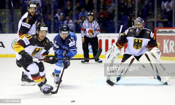 VeliMatti Savinainen of Finland challenges Moritz Mueller of Germany during the 2019 IIHF Ice Hockey World Championship Slovakia group A game between...
