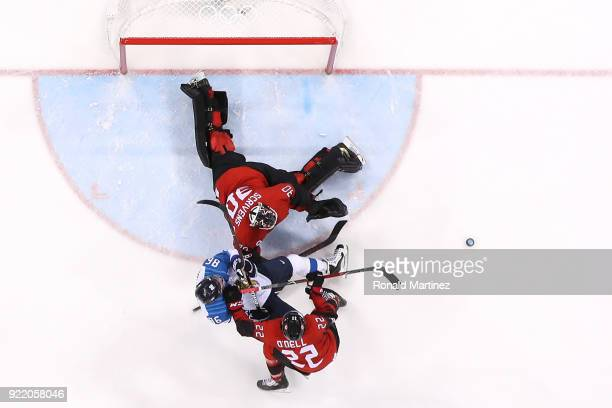 VeliMatti Savinainen of Finland collides with Ben Scrivens of Canada in the second period during the Men's Playoffs Quarterfinals on day twelve of...