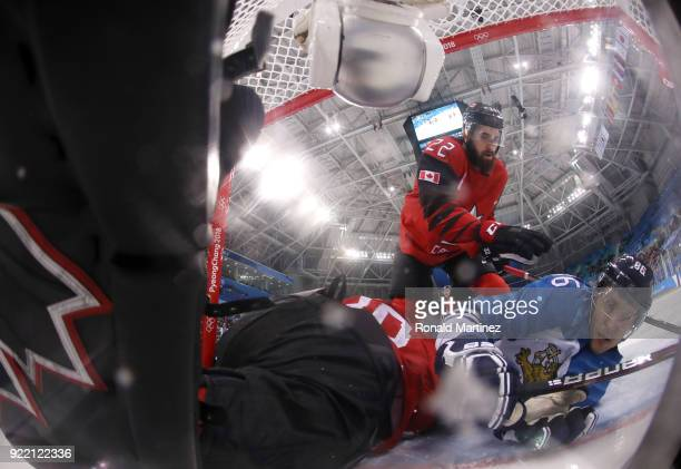 Veli-Matti Savinainen of Finland collides with Ben Scrivens of Canada in the second period during the Men's Play-offs Quarterfinals on day twelve of...