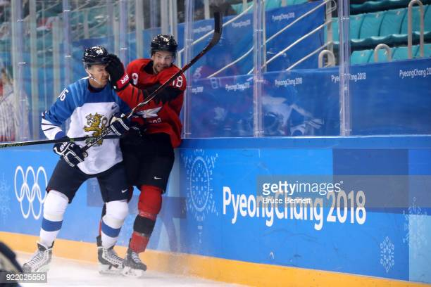 Veli-Matti Savinainen of Finland collides with Marc-Andre Gragnani of Canada in the first period during the Men's Play-offs Quarterfinals on day...