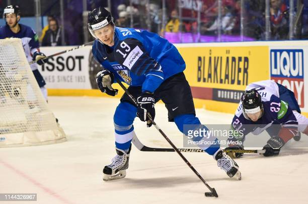 Veli-Matti Savinainen of Finland controls the puck during the 2019 IIHF Ice Hockey World Championship Slovakia group A game between Finland and Great...