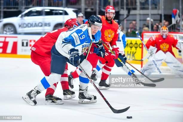 Veli-Matti Savinainen of Finland controls the puck during the 2019 IIHF Ice Hockey World Championship Slovakia semi final game between Russia and...