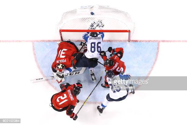 VeliMatti Savinainen of Finland crashes in to the net in the third period against Kevin Poulin of Canada during the Men's Playoffs Quarterfinals on...