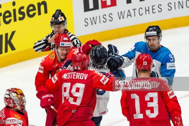 Veli-Matti Savinainen of Finland Finland Nikita Nesterov of Russia during the 2019 IIHF Ice Hockey World Championship Slovakia semi final game...