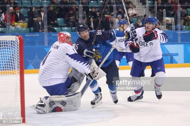 Veli-Matti Savinainen of Finland makes a shot on Matt Dalton of Korea during the Men's Play-offs Qualifications game on day eleven of the PyeongChang...