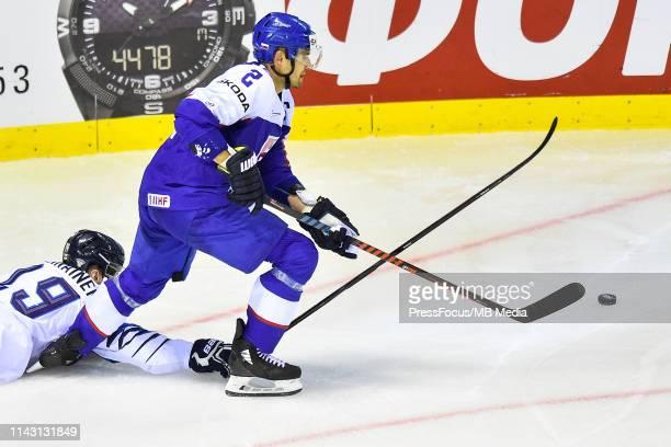 Veli-Matti Savinainen of Finland tackles Andrej Sekera of Slovakia during the 2019 IIHF Ice Hockey World Championship Slovakia group A game between...