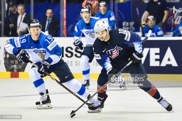 Veli-Matti Savinainen of Finland tackles Derek Ryan of USA during the 2019 IIHF Ice Hockey World Championship Slovakia group A game between United...