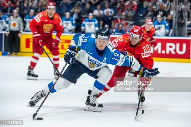 Veli-Matti Savinainen of Finland vies with Nikita Zaitsev of Russia during the 2019 IIHF Ice Hockey World Championship Slovakia semi final game...