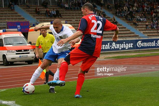 Velimir Grgic of Saarbruecken fights for the ball with Jan-Philipp Hammes of Bonn during the Regionalliga match between Bonner SC and 1.FC...