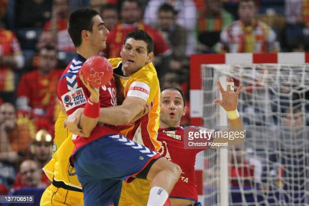 Velko Markoski of Macedonia defends against Zarko Sesum of Serbia during the Men's European Handball Championship second round group one match...