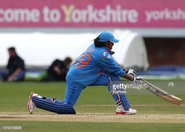 Vellaswamy Vanitha of India sweeps the ball through the leg side during the First One Day International between England Women and India Women at...