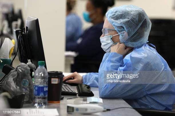 Velocity Urgent Care Nurse Practitioner Diane Alvarez documents coronavirus testing April 15, 2020 in Woodbridge, Virginia. Able to test about 100...