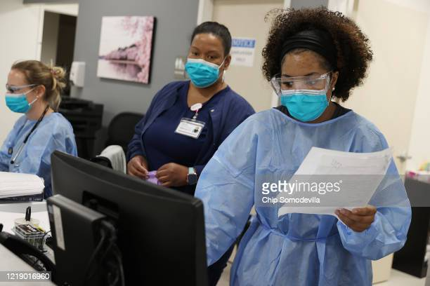 Velocity Urgent Care x-ray technician and medical assistant Britni Chavis and operations coordinator Keyana Joseph of Virginia Beach keep careful...