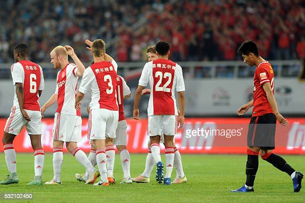 Veltman Joel of Ajax Amsterdam celebrates with teammates after scoring a goal during a friendly match against Chinese Super League club Liaoning...
