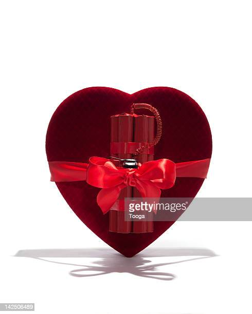 velvet heart with dynamite and bow - explosive material stock photos and pictures