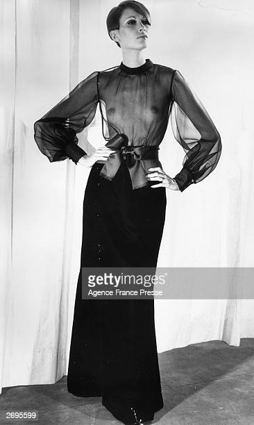 A velvet maxiskirt worn with a longsleeved sheer 'cigaline' top designed by Yves Saint Laurent for his Autumn/Winter 1968/1969 collection