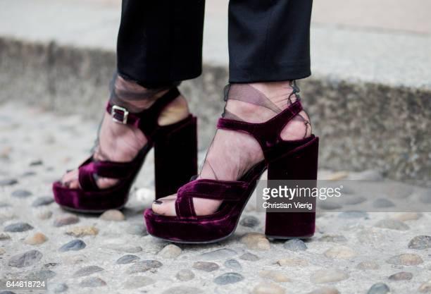 Velvet platform heels with sheer socks outside during Milan Fashion Week Fall/Winter 2017/18 on February 23 2017 in Milan Italy
