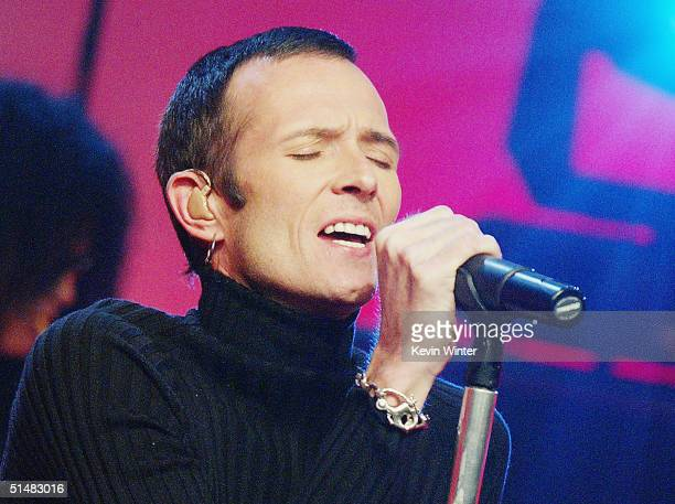 """Velvet Revolver's Scott Weiland performs on """"The Tonight Show with Jay Leno"""" at the NBC Studios on October 14, 2004 in Burbank, California."""