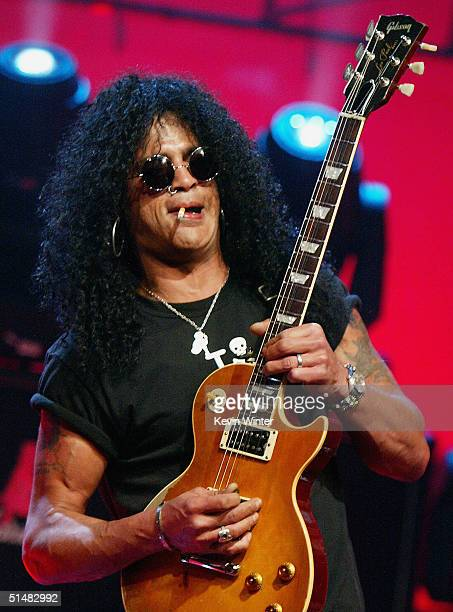 "Velvet Revolver's Slash performs on ""The Tonight Show with Jay Leno"" at the NBC Studios on October 14, 2004 in Burbank, California."