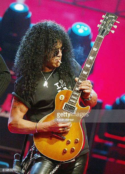 """Velvet Revolver's Slash performs on """"The Tonight Show with Jay Leno"""" at the NBC Studios on October 14, 2004 in Burbank, California."""