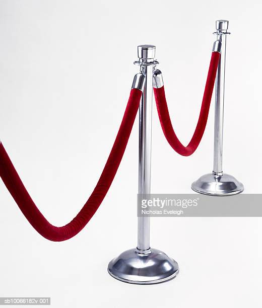velvet rope on white background - cordon boundary stock pictures, royalty-free photos & images