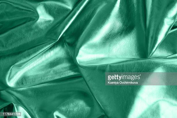 velvet texture neo mint color background, expensive luxury fabric, material, wallpaper. copy space - lippenblütler stock-fotos und bilder