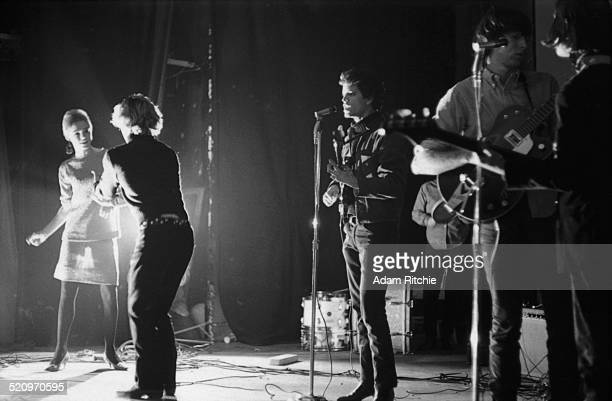 Velvet Underground perform with Edie Sedgwick and Gerard Malanga dancing at NY Filmmakers' Cinematheque New York February 1966 LR Edie Sedgwick...