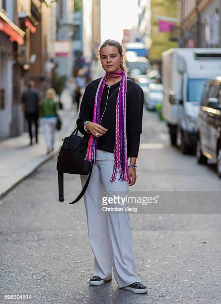 Vendela Barck wearing a pink purple scarf black longshirt white pants during the third day of the Stockholm Fashion Week Spring/Summer 2017 on August...