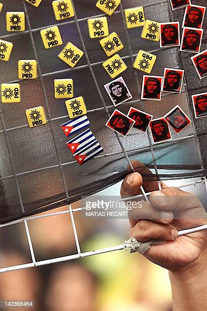 A vender sells buttons bearing the flag of Cuba the image of Che and the flag of the Party for the Democratic Revolution 17 September 1999 The group...