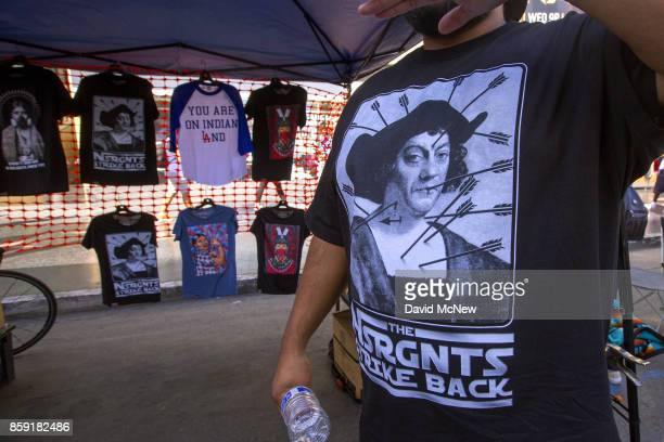 A vender sells Native Americanthemed shirts during an event celebrating Indigenous Peoples Day in the Hollywood area on October 8 2017 of Los Angeles...