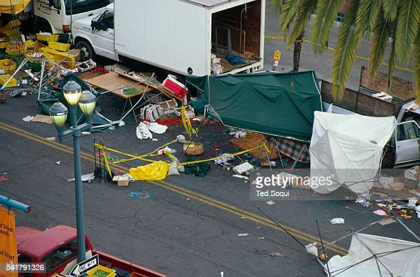 Vender stalls and products are chaotically strewn at the site of the deadly Santa Monica Farmer's Market crash that killed 10 people and injured 63...