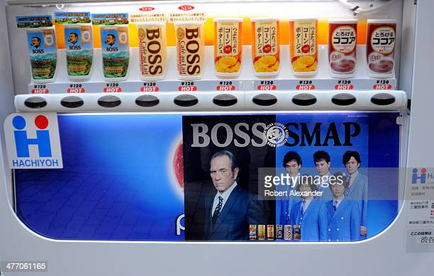 A vending machine filled with cans and bottles of Boss coffee and coffeeflavored beverages features a photo of American actor Tommy Lee Jones The...