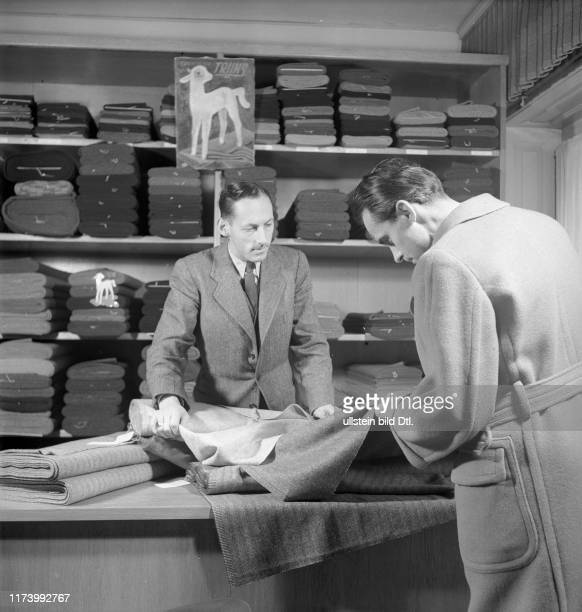 Vendor advices a client for chosing the fabric for a tailormade suit