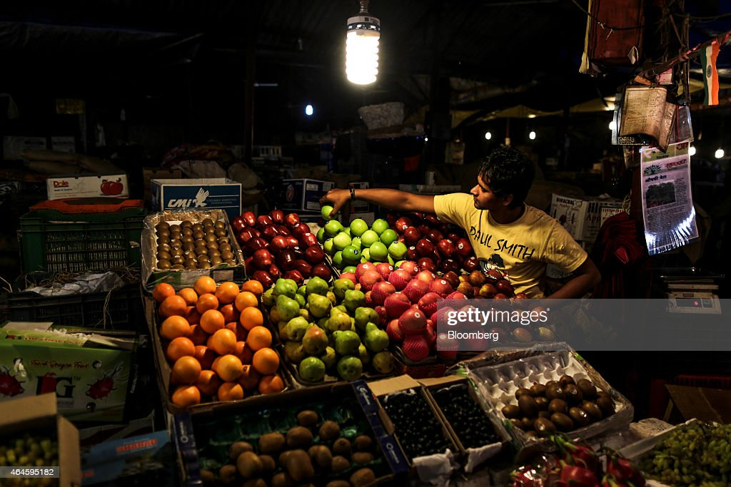 A vendor arranges a display of apples at a fruit stall in Crawford Market in Mumbai, India, on Thursday, Feb. 26, 2015. India's Finance Minister Arun Jaitley will present this year's budget on February 28. Speculation that Prime Minister Narendra Modi's policies will boost economic growth has propelled India's Sensex to the world's third-biggest gain among major markets during the past 12 months. Photographer: Dhiraj Singh/Bloomberg via Getty Images