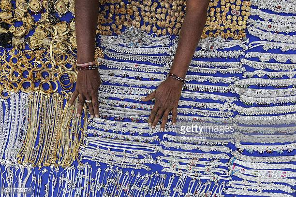 A vendor arranges a display of earrings anklets and bracelets at a market stall in Ahmedabad Gujarat India on Wednesday Jan 11 2017 Hailed as one of...