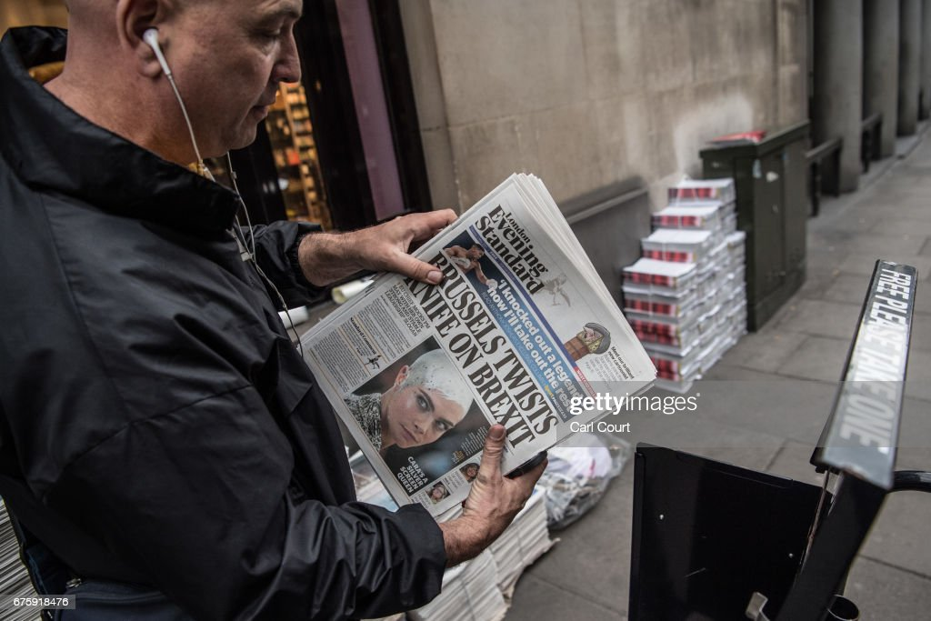 A vendor arranges copies of the Evening Standard newspaper on May 2, 2017 in London, England. Former Chancellor of the Exchequer, George Osborne, today started his first full day as editor of the newspaper having recently announced that he was stepping down from his seat as MP for Tatton following criticism for accepting the position.