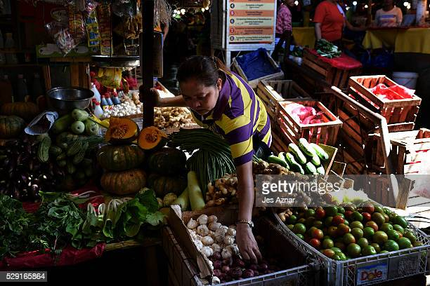 A vendor arranges produce at her stall inside the Bangkerohan market on May 8 2016 in Davao City Mindanao Philippines A city of nearly two million...