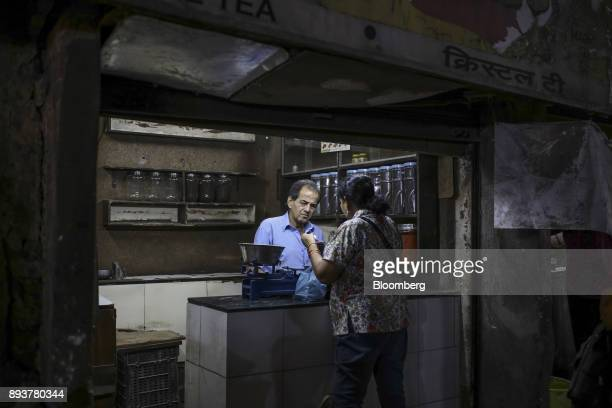 A vendor assists a customer at a tea store in Mumbai India on Friday Dec 15 2017 India's inflation surged past the central bank's target bolstering a...