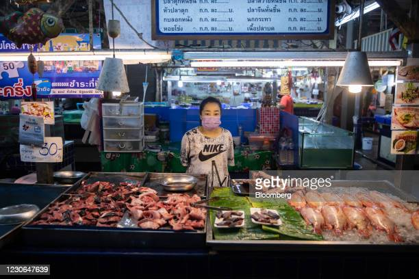 Vendor at a seafood stall in a wet market in Patong, Phuket, Thailand, on Sunday, Dec. 20, 2020. The tepid response to Thailands highly publicized...