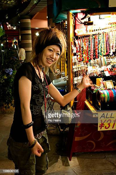 A vendor at her stall in the expansive walkways of Canal City mall in Hakata Fukuoka City built around an artificial canal
