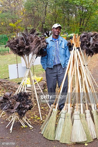 Vendor at Irene Market selling brooms