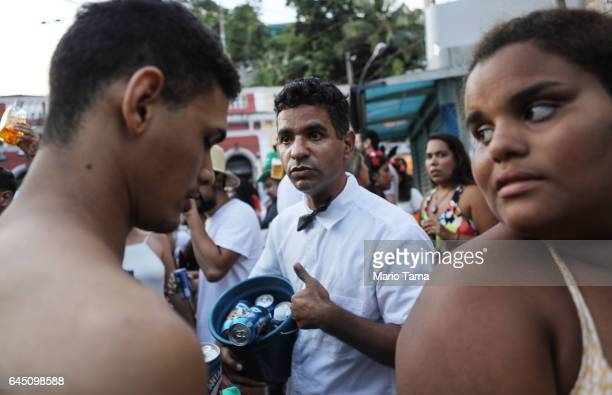 A vendor attempts to sell beers at the Carmelitas 'bloco' or street party on the first official day of Carnival on February 24 2017 in Rio de Janeiro...
